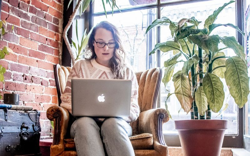 Woman working on her laptop in a coffee shop