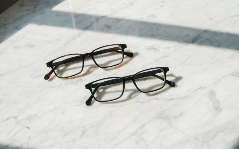 Two Felix Gray Blue Light Glasses on a marble table