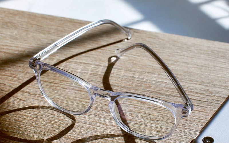 Crystal Clear Roebling glasses on a wooden table with a phone