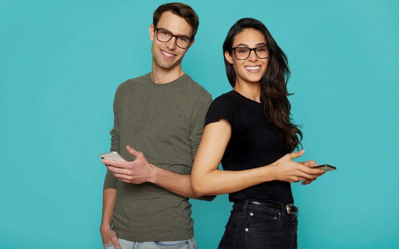 Man and women wearing Felix Gray's Volta oversized glasses
